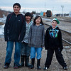 Four young men out for a walk on Butcher Street in Moosonee