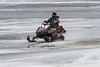 Snowmobile travelling on the ice of the Moose River from Moose Factory to Moosonee 2013 May 1st evening.