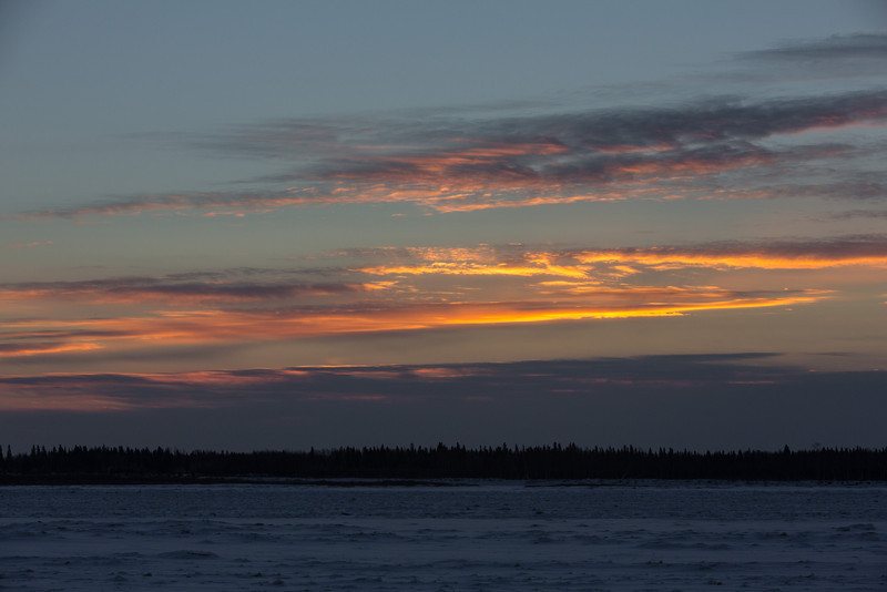 Sky across the Moose River from Moosonee shortly before sunrise.
