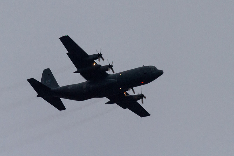RCAF C-130 Hercules over Moosonee and area early on a cloudy morning.