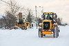 Snow removal on Revillon Road in Moosonee.