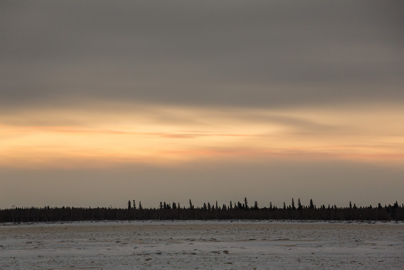 Hints of colour across the Moose River from Moosonee around sunrise.