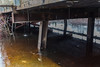 Underneath Atim Road bridge across Store Creek in Moosonee.