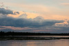 Clouds over the Moose River at Moosonee after a storm.