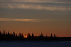 sSunrise over the Moose River at Moosonee. Darker exposure.