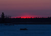 Sky near the south end of Butler Island just before sunrise across from Moosonee. Dump truck on winter road.
