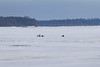 Snowmobile traffic on the Moose River.