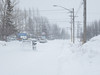 Traffic on Ferguson Road in Moosonee in falling snow.