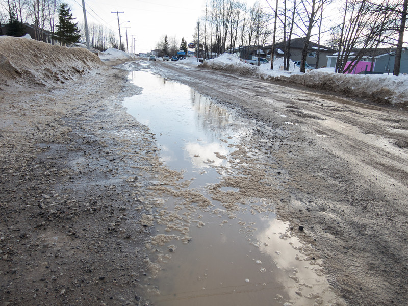 Puddle and potholes on Ferguson Road.