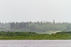 Looking across the Moose River during moderate rain.