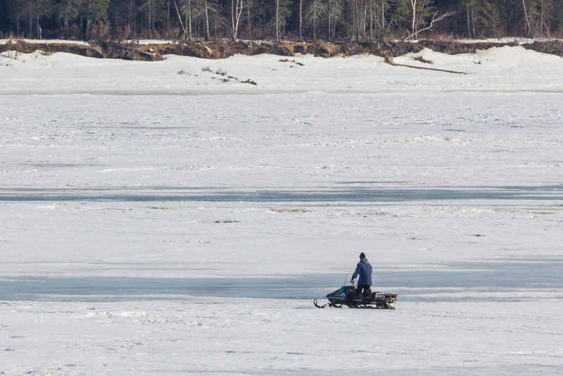 Snowmobile on the Moose River at Moosonee. Late afternoon.