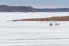 Snowmobile and sled crossing the Moose River.