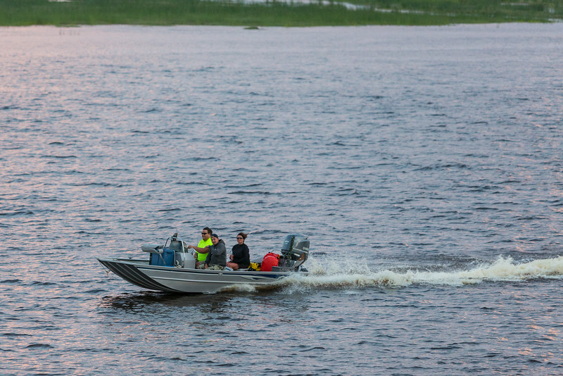 People in a fishing boat on the Moose River.