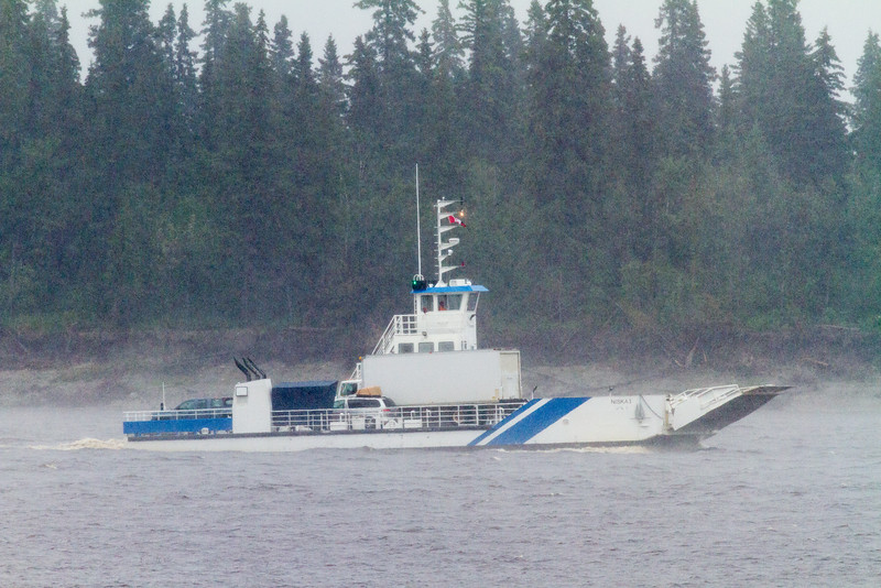 Barge Niska I in moderate rain heading to Moose Factory. Seen in front of Butler Island.