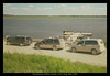 Public docks in Moosonee. Land taxis in foreground. Converted to autochrome.icc profile. Noise added in output according to size.