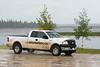 Sudden rain shower in Moosonee. Truck on Revillon Road.