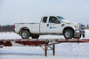 ORICA pickup truck on trailer along the Moose River.