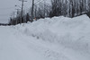 Snowbank along Ferguson Road looking from intersection with Second Street.