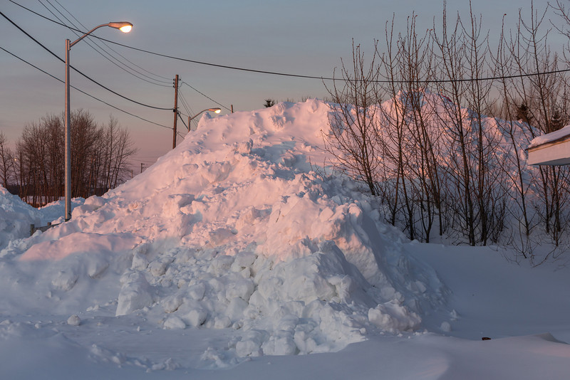 Snow pile near Keewaytinok Native Legal Services. Sunrise 2014 March 6th.