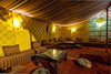 A canopied lounge in the Hotel, Kasbah Hotel Xaluca in Erfoud, Morocco.