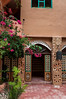 Hotels and restaurants with beaugainvillea flowers and Moroccan architecture in Dades Canyon, Morocco.