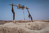 A desert well and bucket raising mechanism in the Sahara Desert near Erfoud, Morocco.