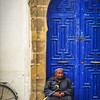 The blind man and the blue door
