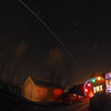 Festive ISS 22 Dec 2013. The International Space Station (ISS) flies over East Midlands (1759hrs flyby).  A very bright flyby passing from the west to east with a festive combo :-)<br /> <br /> How did I capture this? - Camera (Olympus E-M1) with fisheye lens (Oly 8mm) set on tripod. I aligned the west horizon with the Christmas decos to ensure it would originate over. Setting camera in manual mode, f3.5, ISO 320 & 10s exposure time & using remote cable to shoot continuous for approx a dozen or so shots. The garage and trees given a bit of illumination from painting with a torch. Once complete I imported all images & stacked in software to produce this composite image.