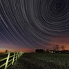 StarTrail 01/02 Feb 2015, Leicestershire, UK. 6 hour, 1500 exposures Star Trail captured with Olympus OM-D E-M5 & 7-14mm lens. The image is composed around the North Star (Polaris), the pole star around which all others spin.<br /> How did I capture it? - Camera on tripod F4, ISO 320, 15s. Manual focus set to infinity I composed the image around the North Star (Polaris) to ensure a swirly star trail above the country properties. The first shot was captured/exposed through the lcd screen and then using the remote cable (set to lock) and turning off lcd (maximise battery) I depressed shutter. This allowed the camera to shoot continuous for 6 hours (using 2 battery pack). I transferred all images (High res JPEG) to MAC and imported/stacked in StarStax software. Plane trails removed using Pixelmator software. The final composite reveals 6 hrs of Earth spinning, as shown through the stars.