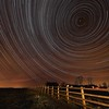 StarTrail 10/11 Jan 2015, Leicestershire, UK. 7 hour, 1700 exposures Star Trail captured with Olympus OM-D E-M5 & 7-14mm lens. The image is composed around the North Star (Polaris), the pole star around which all others spin.<br /> How did I capture it? - Camera on tripod F4, ISO 320, 15s. Manual focus set to infinity I composed the image around the North Star (Polaris) to ensure a swirly star trail above the country properties. The first shot was captured/exposed through the lcd screen and then using the remote cable (set to lock) and turning off lcd (maximise battery) I depressed shutter. This allowed the camera to shoot continuous for 7 hours (using 2 battery pack). I transferred all images (High res JPEG) to MAC and imported/stacked in StarStax software. Plane trails removed using Pixelmator software. The final composite reveals 7 hrs of Earth spinning, as shown through the stars.