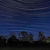 StarTrail 25/26 May 2014, Leicestershire, UK. Reverse curvature startrail captured with Olympus OM-D E-M1 & 7-14mm lens. If you look closely the image contains 1 Iridium flare, 4 meteors and the 0225hrs ISS flyby. A nice composite capture :-)<br /> How did I capture it? - Camera on tripod F4, ISO 320, 15s. Manual focus set to infinity I pointed the camera due south to ensure a star reversal curvature. The first shot was captured/exposed through the lcd screen and then using the remote cable (set to lock) and turning off lcd (maximise battery) I depressed shutter. This allowed the camera to shoot continuous for 5 hours.  To complete the process I transferred all images (High res JPEG) to MAC and imported/stacked in StarStax software. Plane trails removed using Pixelmator software. The final composite reveals stars reverse arcing above and below the celestial equator.