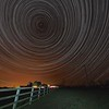 As featured on ITV Central news 22 January 2015. StarTrail 17/18 Jan 2015, Leicestershire, UK. 7 hour, 1700 exposures Star Trail captured with Olympus OM-D E-M5 & 7-14mm lens. The image is composed around the North Star (Polaris), the pole star around which all others spin.<br /> How did I capture it? - Camera on tripod F4, ISO 320, 15s. Manual focus set to infinity I composed the image around the North Star (Polaris) to ensure a swirly star trail above the country properties. The first shot was captured/exposed through the lcd screen and then using the remote cable (set to lock) and turning off lcd (maximise battery) I depressed shutter. This allowed the camera to shoot continuous for 7 hours (using 2 battery pack). I transferred all images (High res JPEG) to MAC and imported/stacked in StarStax software. Plane trails removed using Pixelmator software. The final composite reveals 7 hrs of Earth spinning, as shown through the stars.