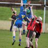 030814  Munster Colleges Senior B' Hurling Final  Colaiste Phobal Roscrea v Cashel Community School.    Cashel Community School's David Wade makes the high ball against Roscrea Colaiste Phobal's Evan Fitzpatrick and Aarron Kirwan.  Photo Andy Jay.