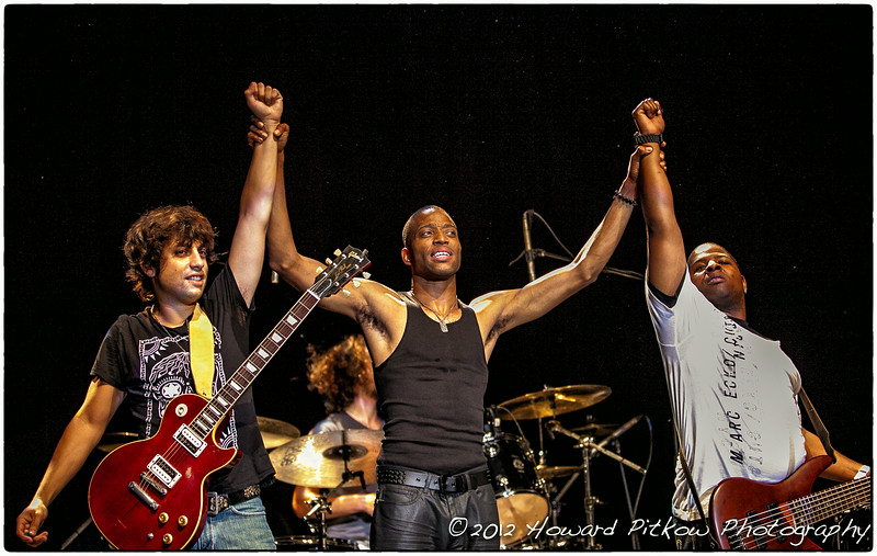 Trombone Shorty and band members taking a bow following a sold out performing at the Keswick Theatre in Glenside, PA (Howard Pitkow/for Newsworks)