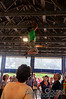 A kid climbing in the rafters at the What Cheer? Brigade show.