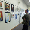 051109 : 5th Cong. District Art Show  : TYN_ Student art is viewed at i the 2009 5th Cong. Dist Art Show, Monday at the  Chelmsford Public Library. ..Sun Photo Bob Whitaker_DIG#821