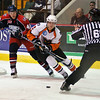 David Liffiton of Syracuse crunch and Joonas Lehtivuori of the Adirondack Phantoms fight for the puck before a referee pauses the game Sunday night. Photo Eric Jenks 11/1/09