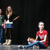 Belle (Chloe Yettru, bottom right), Kalyla Foster and Madison Gemerek watch as part of Beauty and the Beast starts to unfold during a rehearsal Tuesday night at the BSHS Auditorium. Photo By Eric Jenks