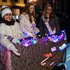Alyssa Litvaitis toss candy out to waiting children while her compatriots Jennifer Pollard and Madison Manvel look on during the annual Holiday Parade in Ballston Spa Friday Night. Photo By Eric Jenks 12/3/10