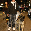 Seth Yunes walks Lucas from the Saratoga Springs Animal Shelter during the annual Holiday Parade in Ballston Spa Friday Night. Photo By Eric Jenks 12/3/10