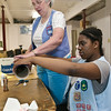Sally Jenkins and Miriam Emerson work on creating candle sticks for the parade float