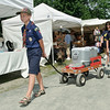 Boy Scouts Brendan Barrow and Alex Bianconi pull a cart of ice cold beverages around the Round Lake Craft Fair