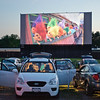 A scene from Toy Story 3 shows on the screen at the malta drive-in.