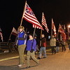 Ballston Spa Boyscout Troup 1 marches with their collection of flags during the Ballston spa Holiday Parade Friday. Photo By Eric Jenks 12/3/10
