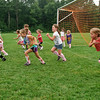 Calleigh Sisk (far left) and other children run during a game at the Bspa Soccer camp