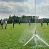 Water gushes every where while Nick Paone launches his rocket to the sky