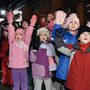 Children Wave as Santa comes through the Ballston Spa Holiday Parade on the back of a Firetruck Friday Evening. Photo By Eric Jenks 12/3/10