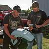 Tom Bradbury and Troy Woodward look at a new fender. Photo By Eric Jenks