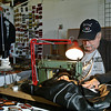 Jim Skinner sows a patch onto a leather jacket at the goat brothers swapmeet. Photo Eric Jenks