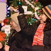 Tom and Mirna Caro from Furniture Theatre/Malta Drive in toss candy to waiting children during the Ballston Spa Holiday Parade Friday night.  Photo By Eric Jenks 12/3/10
